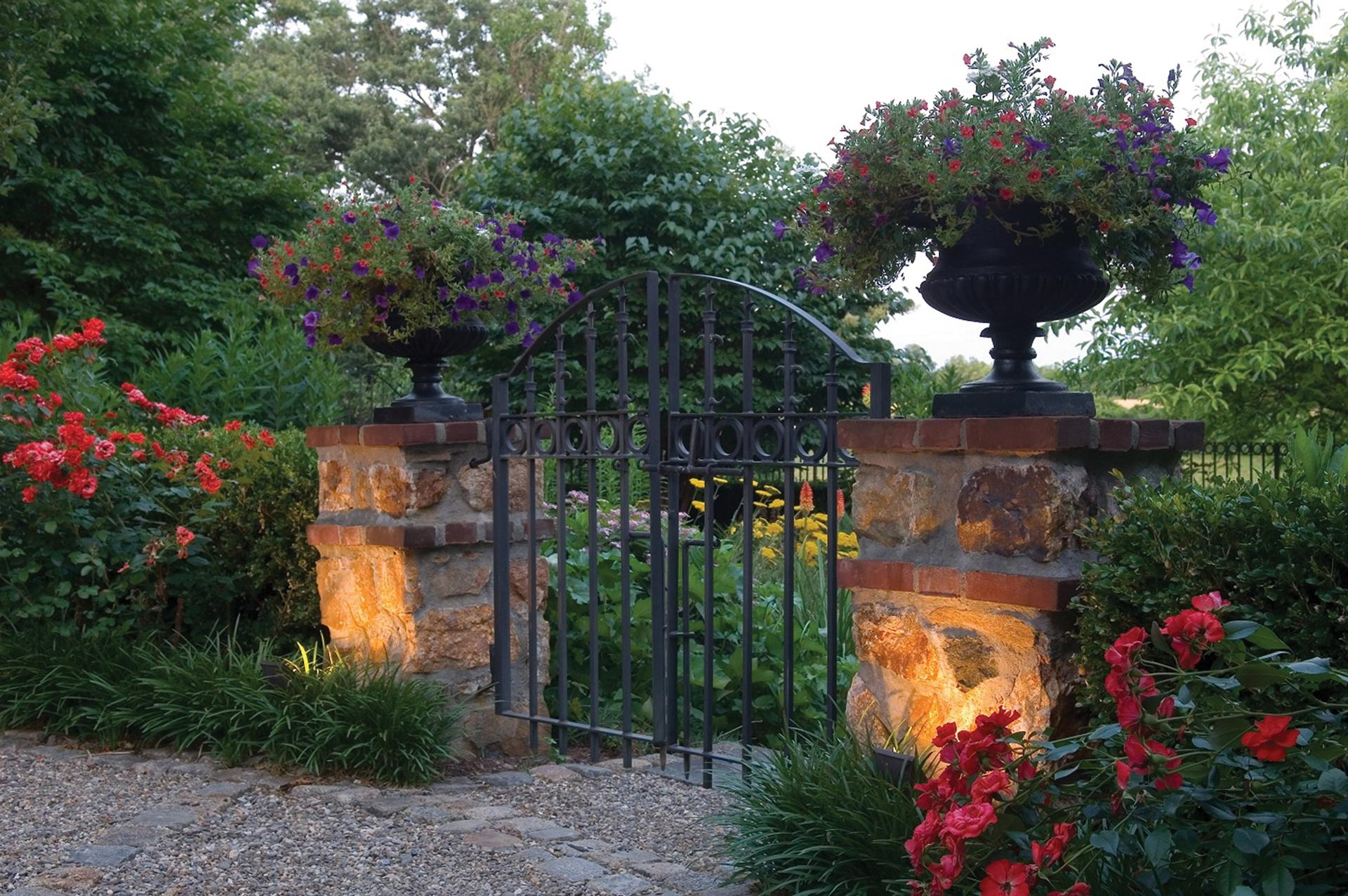 stunning-gate-iron-work-outdoor-lighting-nightlight-stone-piers-columns-statue-gardening